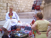 Lady in national costume producing traditional Dubrovnik cloth articles
